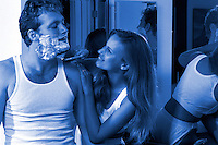 Couple in bathroom playing with shaving cream