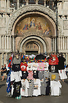 Venice Italy 2009. Tourists souvenier stall outside Basilica San Marco. Saint Marks Square Piazza San Marco.
