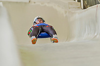 5 December 2014: Pavel Angelov, sliding for Bulgaria, crosses the finish line on his first run, ending the day with a 26th place finish and a combined 2-run time of 1:47.539 in the Men's Competition at the Viessmann Luge World Cup, at the Olympic Sports Track in Lake Placid, New York, USA. Mandatory Credit: Ed Wolfstein Photo *** RAW (NEF) Image File Available ***