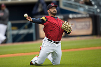 Toledo Mud Hens pitcher Arcenio Leon (34) makes a throw to first base from his knees against the Lehigh Valley IronPigs during the International League baseball game on April 30, 2017 at Fifth Third Field in Toledo, Ohio. Toledo defeated Lehigh Valley 6-4. (Andrew Woolley/Four Seam Images)