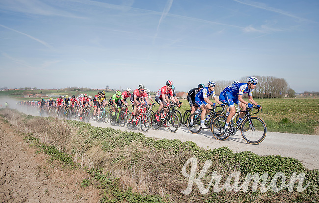 peloton led by Zdenek Stybar (CZE/Quick Step Floors racing over the newly added gravel roads around Ploegsteert, called 'Plugstreets'<br /> <br /> 79th Gent-Wevelgem 2017 (1.UWT)<br /> 1day race: Deinze › Wevelgem - BEL (249km)