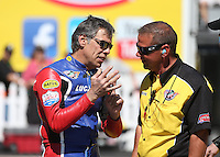 Mar. 16, 2013; Gainesville, FL, USA; NHRA pro stock motorcycle rider Hector Arana Sr (left) with NHRA official during qualifying for the Gatornationals at Auto-Plus Raceway at Gainesville. Mandatory Credit: Mark J. Rebilas-