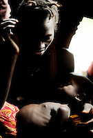 """Bankapo Kanu from Amdalei village, near Lunsar in Sierra Leone, had a very difficult delivery during her last birth that lasted for 2 days. She felt ill for 3 months afterwards. She said she would have liked to go to the hospital but the family has no money. She has born 6 children so far, 3 have not survived. """"When you give birth, the traditional birth attendants just say push, push and that's what I do, there's nothing else for us."""""""