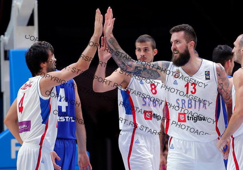 Serbia's Milos Teodosic, Nemanja Bjelica and Miroslav Raduljica celebrate during European championship quarter-final basketball match between Serbia and Czech Republic on September 16, 2015 in Lille, France  (credit image & photo: Pedja Milosavljevic / STARSPORT)