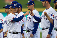 Round Rock Express second baseman Brent Lillibridge #18 is greeted by his teammates before the Pacific Coast League baseball game against the Oklahoma City Redhawks on April 3, 2014 at the Dell Diamond in Round Rock, Texas. The Redhawks defeated the Express 7-6 in the season opener for both teams. (Andrew Woolley/Four Seam Images)