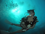 Orchid Island, Taiwan -- A diver against the ocean surface near 'Little Orchid Island'.