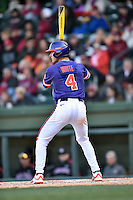 Clemson Tigers shortstop Eli White (4) awaits a pitch during a game against the South Carolina Gamecocks at Fluor Field February 28, 2015 in Greenville, South Carolina. The Gamecocks defeated the Tigers 4-1. (Tony Farlow/Four Seam Images)