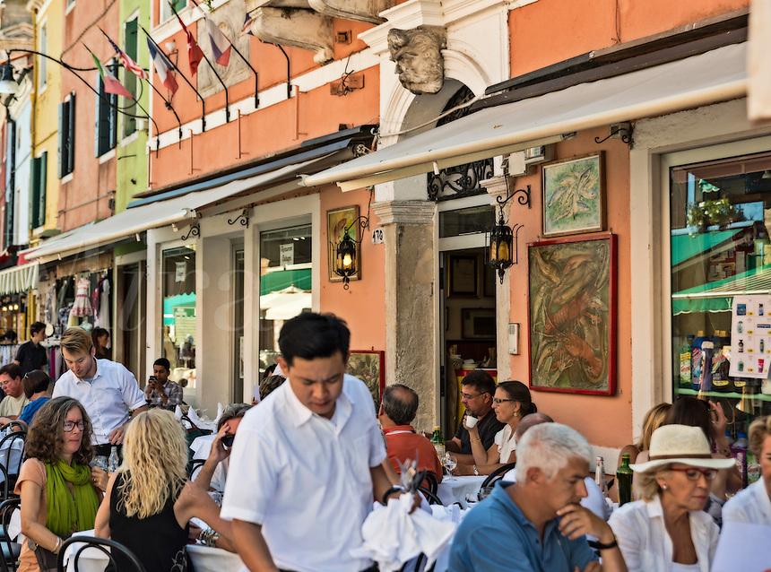 Patrons at an outdoor cafe restaurant, Burano, Venice, Italy