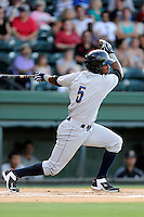 Third baseman Miguel Andujar (5) of the Charleston RiverDogs bats in a game against the Greenville Drive on Thursday, August 21, 2014, at Fluor Field at the West End in Greenville, South Carolina. Andujar is the No. 18 prospect of the New York Yankees, according to Baseball America. Charleston won, 12-0. (Tom Priddy/Four Seam Images)