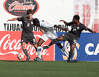 Jack McInerney and Joseph Gyau battle for the ball against Canada player. US Men's National Team Under-17 defeated Canade 4-2 in the 2009 CONCACAF Under-17 Championship on April 23 in Tijuana, Mexico.