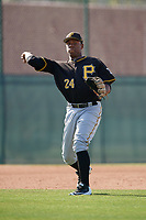 Pittsburgh Pirates third baseman Julio de la Cruz (24) throws to first base during a minor league Extended Spring Training intrasquad game on April 1, 2017 at Pirate City in Bradenton, Florida.  (Mike Janes/Four Seam Images)