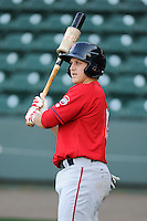 Catcher Jake Romanski (12) of the Greenville Drive waits his turn for batting practice on the team's Media Day first workout on Tuesday, April 1, 2014, at Fluor Field at the West End in Greenville, South Carolina. (Tom Priddy/Four Seam Images)