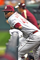 Florida State Seminoles pitcher/outfielder Jameis Winston #44 watches from the dugout during a game against the Clemson Tigers at Doug Kingsmore Stadium on March 22, 2014 in Clemson, South Carolina. The Seminoles defeated the Tigers 4-3. (Tony Farlow/Four Seam Images)