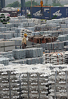 An aluminium depot in Foshan, Guangdong Province, China, is overflowing with aluminium ingots.The economic down-turn has resulted in a slowing in orders for aluminium and it's market price, along with most other raw materials..24 Apr 2009