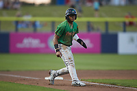 Marcus Smith (15) of the Down East Wood Ducks takes his lead off of third base against the Kannapolis Cannon Ballers at Atrium Health Ballpark on May 5, 2021 in Kannapolis, North Carolina. (Brian Westerholt/Four Seam Images)