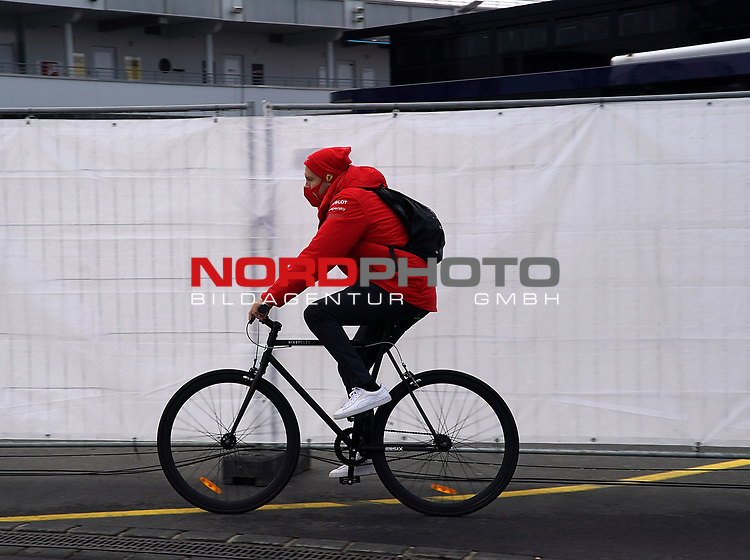 11.10.2020, Nürburgring, Nürburg, Formula 1 Aramco Grosser Preis der Eifel 2020<br /> , im Bild<br />Sebastian Vettel (GER#5), Scuderia Ferrari kommt mit dem Fahrrad in das Fahrerlager<br /> <br /> Foto © nordphoto / Bratic