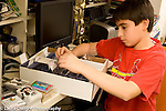 11 year old boy sorting and filing his extensive baseball card collection corresponds and buys and sells with adult collectors