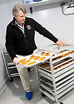 WATERBURY CT. - 18 December 2020-121820SV07-Eric Pederson, President and CEO, checks on smoked salmon at Ideal Fish in Waterbury Friday. Ideal Fish is a big aquaculture business that moved into an industrial space in the city's East End a year or two ago.<br /> Steven Valenti Republican-American