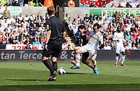 Pictured L-R: Match referee Mike Jones watches on as David Silva of Manchester City challenges Leon Britton of Swansea which goes wide, while he is chased by Samir Nasri and Matija Nastasic of Manchetser City. Saturday 04 May 2013<br />