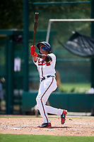 GCL Braves shortstop Juan Morales (24) follows through on a swing during the first game of a doubleheader against the GCL Yankees West on July 30, 2018 at Champion Stadium in Kissimmee, Florida.  GCL Yankees West defeated GCL Braves 7-5.  (Mike Janes/Four Seam Images)