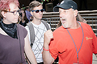 Counter-protesters (rear) yell at a man trying to attend the rally after the Straight Pride Parade in Boston, Massachusetts, on Sat., August 31, 2019. The man turned away and left.