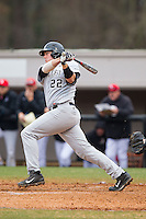 Will Craig (22) of the Wake Forest Demon Deacons follows through on his swing against the Davidson Wildcats at Wilson Field on March 19, 2014 in Davidson, North Carolina.  The Wildcats defeated the Demon Deacons 7-6.  (Brian Westerholt/Four Seam Images)