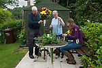 Fownhope Heart of Oak Society Herefordshire 2018.  Club Walk Day. Established as a Friendly Society in 1876 and reformed in 1989 when the law was changed regarding Friendly Societies.<br /> <br /> Mike and Rose Andrews with their grand daughter Vicky make a flower stick.