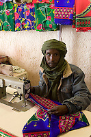 Tripoli, Libya - Ali, Libyan Tuareg Tailor, Tripoli Medina.  His traditional male Tuareg veil (tagulmust) and Western-style denim jacket are a synthesis of modern and traditional attire.