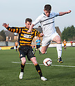 Raith Rovers' Dougie Hill gets to the ball ahead of Alloa's Andrew Kirk
