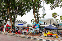 Kuala Lumpur, Malaysia. People Gathering at Food Vendors after Mid-day Friday Prayers, Masjid Negara.