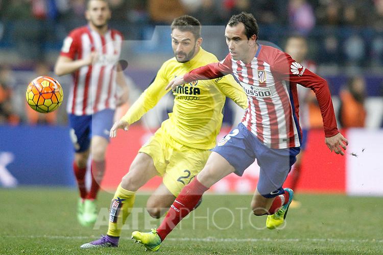 Atletico de Madrid's Diego Godin (r) and Villareal's Adrian Lopez during La Liga match. February 21,2016. (ALTERPHOTOS/Acero)