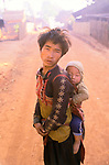 Opium addict with child his son Hmong village Northern Thailand South East Asia 1990s