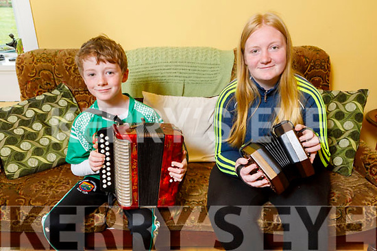 """Sarah and Donnchadh Leane from Milltown practicing with their concertina and accordion for the """"Stars in the Livingroom"""" fundraiser for Milltown/Castlemaine GAA Club."""