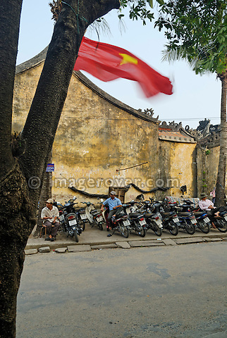 Asia, Vietnam, Hoi An. Hoi An old quarter. Motorbike parking with an attendant. The historic buildings, attractive tube houses, and decorated community halls have 1999 earned Hoi An's old quarter the status of a UNESCO World Heritage Site. To protect the old quarter's character stringent conversation laws prohibit alterations to buildings, as well as the presence of cars on the roads.