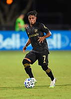 LAKE BUENA VISTA, FL - JULY 18: Latif Blessing #7 of LAFC dribbles the ball during a game between Los Angeles Galaxy and Los Angeles FC at ESPN Wide World of Sports on July 18, 2020 in Lake Buena Vista, Florida.