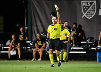 LAKE BUENA VISTA, FL - JULY 26: Referee Alex Chillowicz issues a yellow card during a game between New York City FC and Toronto FC at ESPN Wide World of Sports on July 26, 2020 in Lake Buena Vista, Florida.