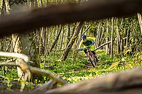 A mountain biker Jon Lindgren rides a single track trail through the Änggårdsbergen Nature Reserve, Gothenburg, Sweden