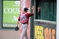 "Pitcher John Mincone (25) of the Savannah Sand Gnats totes the snacks to the bullpen in a pink ""My Little Pony"" backpack before a game against the Greenville Drive on Sunday, August 24, 2014, at Fluor Field at the West End in Greenville, South Carolina. Greenville won, 8-5. (Tom Priddy/Four Seam Images)"