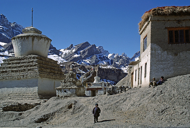 LADAKHI CHILDREN, and CHORTENS (symbols of the universe) bask in the warm Himalayan sun, MULBEKH - LADAKH, INDIA