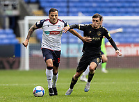 Bolton Wanderers' Antoni Sarcevic competing with Oldham Athletic's Callum Whelan (right) <br /> <br /> Photographer Andrew Kearns/CameraSport<br /> <br /> The EFL Sky Bet League Two - Bolton Wanderers v Oldham Athletic - Saturday 17th October 2020 - University of Bolton Stadium - Bolton<br /> <br /> World Copyright © 2020 CameraSport. All rights reserved. 43 Linden Ave. Countesthorpe. Leicester. England. LE8 5PG - Tel: +44 (0) 116 277 4147 - admin@camerasport.com - www.camerasport.com