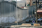 A picture shows a side of the Israeli separation wall arround Jerusalem in Jerusalem's Old city,on March 8, 2020. In June 2002, the Israeli cabinet decided to construct the separation wall. The decision was made following a long string of attacks perpetrated by Palestinians against Israelis. The declared objective was preventing Palestinians without permits from entering Israel from the West Bank. However, the establishment of the barrier was also intended to serve other, undeclared aims. A key factor in determining the barrier's route was the location of settlements, thereby laying the groundwork for the de facto annexation of most of the settlements and much land for their future expansion. Photo by Muhammed Qarout Idkaidek