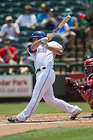 Round Rock Express outfielder Ryan Strausborger #6 follows through on his swing during the Pacific Coast League baseball game against the Memphis Redbirds on April 27, 2014 at the Dell Diamond in Round Rock, Texas. The Express defeated the Redbirds 6-2. (Andrew Woolley/Four Seam Images)