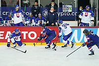 23rd May 2021, Riga Olympic Sports Centre Latvia; 2021 IIHF Ice hockey, Eishockey World Championship, Great Britain versus Slovakia;  20 Jonathan Phillips Great Britain try to push the puck out off the defensive zone 34 Peter Cehlarik Slovakia and 44 Mislav Rosandic Slovakia tries to stop him
