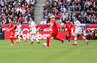 CARSON, CA - FEBRUARY 9: Sophie Schmidt #13 of Canada passes the ball during a game between Canada and USWNT at Dignity Health Sports Park on February 9, 2020 in Carson, California.