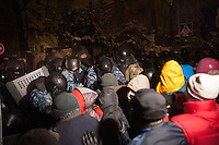 Groups of protesters face a deployment of riot police during the evacuation operations. Kiev. Ukraine
