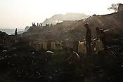 Local vendors collect coal in the early hours of the morning in Borapahari in Jharia, Jharkhand, India. Photo: Sanjit Das