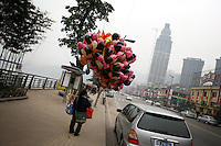 CHINA. Sichuan Province. Chongqing. A woman selling balloons. Chongqing is a city of over 3,000,000 people, famed for being the capital of China between 1938 and 1946 during World War II. It is situated on the banks of the Yangtze river, China's longest river and the third longest in the world. Originating in Tibet, the river flows for 3,964 miles (6,380km) through central China into the East China Sea at Shanghai.  2008.