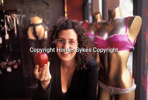 Sam Roddick portrait in her sex fetish shop CoCo de Mer, Soho, London UK 2000s.