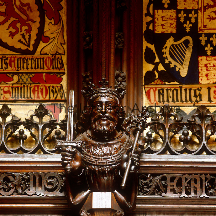 The panelling in the Lords' Chamber is enriched with small wooden busts of the Kings of England