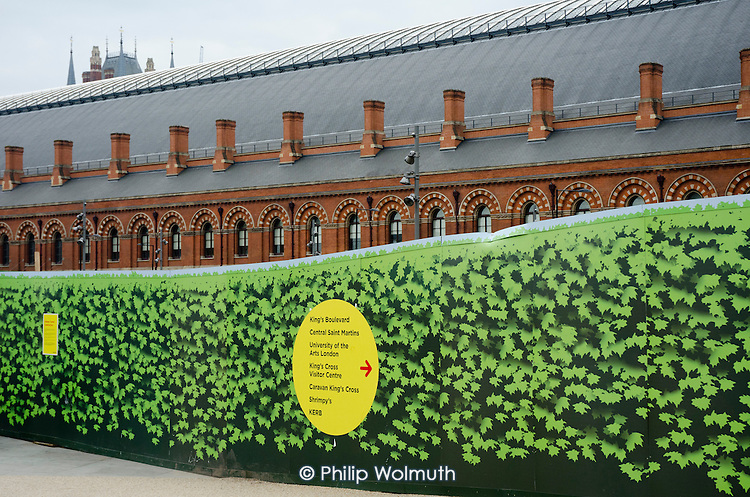Hoarding around a construction site adjacent to St.Pancras Station, London, part of the residential and office redevelopment of King's Cross.